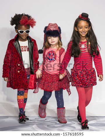 NEW YORK - OCTOBER 5: Models walk the runway at the Truly Scrumptious designed by Heidi Klum at Vogue Bambini - Petite Parade Kids Fashion Week on OCTOBER 5, 2013 in New York - stock photo