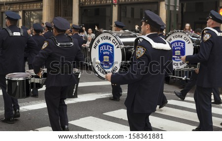 NEW YORK - OCTOBER 14: New York City Police band attends annual Columbus Day Parade on 5th Avenue on October 14, 2013 in New York City