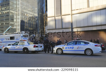 NEW YORK  - OCTOBER 12: NYPD officers providing security near Penn Station in NYC on October 12, 2014.  The New York Police Department, established in 1845, is the largest police force in USA - stock photo