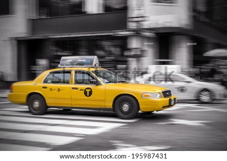 NEW YORK - OCTOBER 16: Panning shot of a NYC Taxi Cab at fifth avenue. New York City, on October 16, 2013. - stock photo