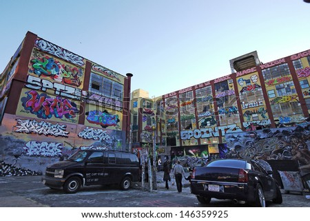 NEW YORK - OCTOBER 4: 5 Pointz is a cultural landmark for hip-hop in Queens on October 4 2010. it is likely to be demolished by September 2013 and build two apartment buildings in the future. - stock photo