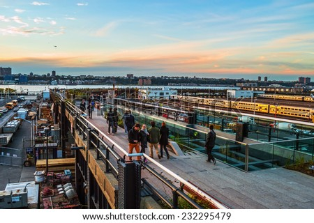 NEW YORK-OCTOBER 20: Sunset view over the Hudson River from the High Line Park on October 20, 2014 in Manhattan. - stock photo