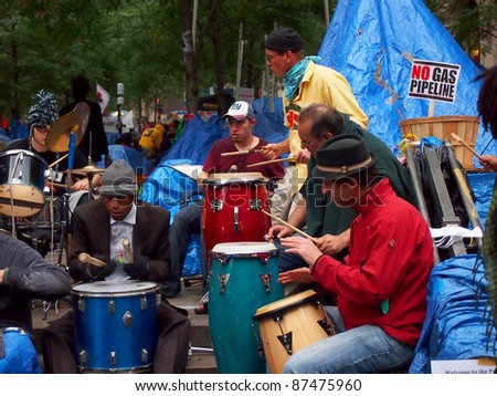 NEW YORK - OCTOBER 26: Unidentified drummers play at the Occupy Wall Street movement, October 26, 2011 in New York City, NY. The protest against the financial system began in Zuccotti Park on September 17, 2011.