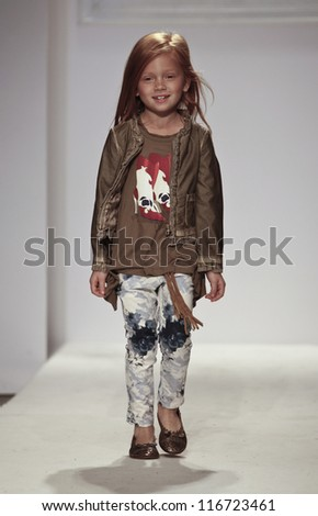 NEW YORK - OCTOBER 21: unidentified Girl walks runway for petite Parade show by Monnalisa during kids fashion week sponsored by Vogue Bambini at Industria Superstudio on October 21, 2012 in New York City