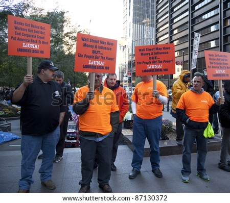 NEW YORK - OCTOBER 21: Union Local 108 members join protesters at 'Occupy Wall Street' camp in Zuccotti Park in Downtown Manhattan on October 21, 2011 in New York. - stock photo