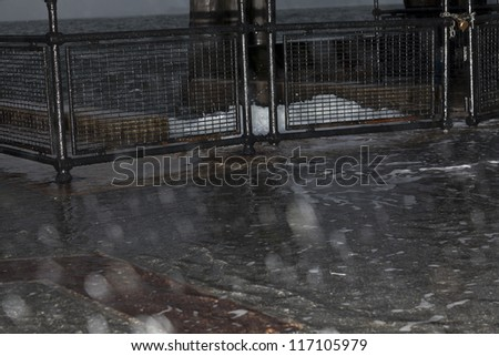NEW YORK - OCTOBER 29: Water surging on embankment in Battery Park as result of hurricane Sandy on October 29, 2012 in New York City