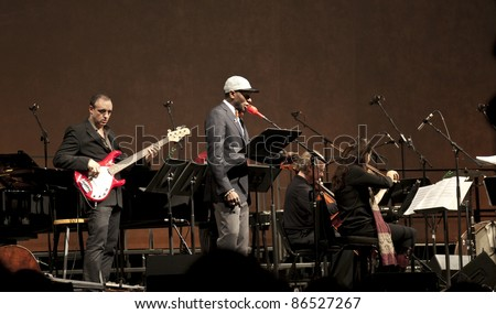 NEW YORK - OCTOBER 12: Yasiin Bey formerly Mos Def performs with Brooklyn philharmonic under Alan Pierson in Financial Center Winter Garden on October 12, 2011 in NYC