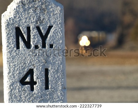 New York 41 old stone marker with train coming - stock photo