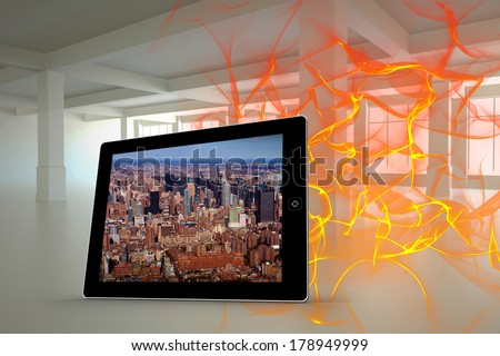 New york on tablet screen against abstract design in orange