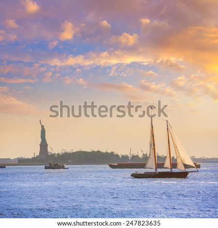 New York sailboat sunset and Statue of Liberty from Manhattan US - stock photo