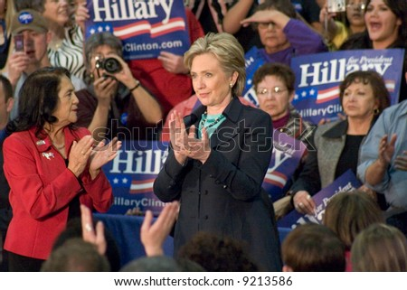 New York Senator Hillary Rodham clapping during a presidential campaign rally in February, 2008.  New Mexico - stock photo