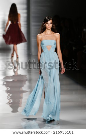 NEW YORK-SEP 8: A model walks the runway at the Reem Acra fashion show during Mercedes-Benz Fashion Week Spring/Summer 2015 at The Salon at Lincoln Center on September 8, 2014 in New York City. - stock photo