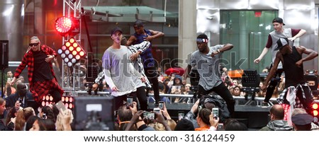 NEW YORK-SEP 10: Singer Justin Bieber performs on NBC's 'TODAY Show' at Rockefeller Plaza on September 10, 2015 in New York City. - stock photo