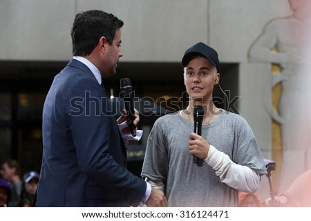 NEW YORK-SEP 10: Singer Justin Bieber (R) and Carson Daly on NBC's 'TODAY Show' at Rockefeller Plaza on September 10, 2015 in New York City. - stock photo