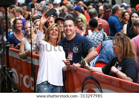 NEW YORK-SEP 4: TV personality Hoda Kotb (L) takes a selfie with a fan as Brad Paisley (not pictured) performs at NBC's TODAY Show at Rockefeller Plaza on September 4, 2015 in New York City. - stock photo