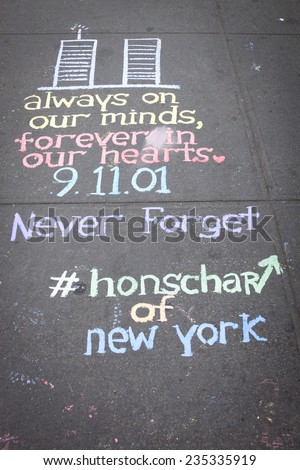 NEW YORK - SEPT 11, 2014: A drawing of the World Trade Center twin towers and a quote written in colorful chalk by New York City artist Hans Honchar on the sidewalk near the WTC in Manhattan. - stock photo