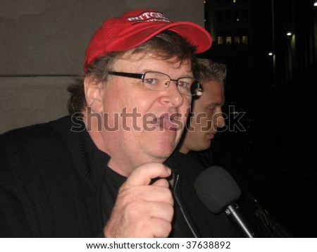 NEW YORK - SEPT 22: Director Michael Moore speaks to reporters near the NY Stock Exchange on September 22, 2009 in New York City - stock photo