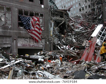 NEW YORK - SEPT 20 :  Flag on building across the street from Ground Zero World Trade Centre on September 20, 2001 in New York. - stock photo