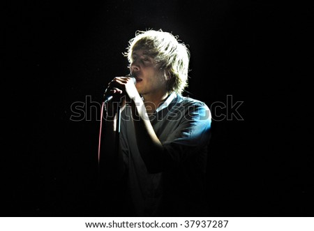 NEW YORK - SEPT 22: French pop act Phoenix (singer Thomas Mars) performs at Summerstage September 26, 2009 in New York City - stock photo