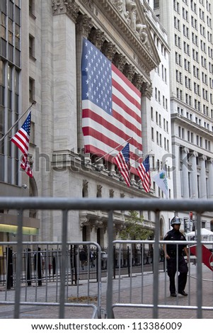 NEW YORK - SEPT 17: Police clear the area in front of the entrance to the NY Stock Exchange on the 1yr anniversary of the Occupy Wall St protests on September 17, 2012 in New York City, NY. - stock photo