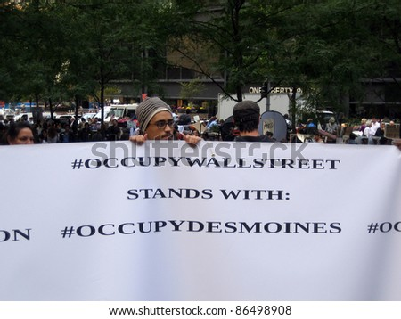 NEW YORK - SEPT 23: Protester holds up sign at Zuccotti Park, September 23, 2011 in New York City. - stock photo