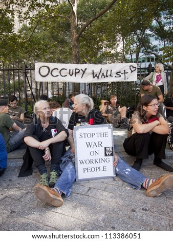 NEW YORK - SEPT 17: Protesters gathering along the fence in Bowling Green Park on the 1yr anniversary of the Occupy Wall St protests on September 17, 2012 in New York City, NY. - stock photo