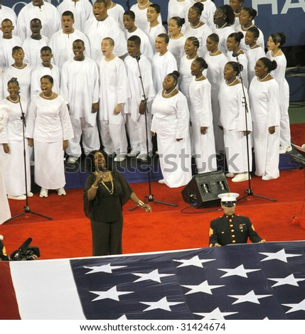 NEW YORK - SEPT 9: Singer Gladys Knight performs 'God Bless America' before the women's final between Maria Sharapova and Justine Henin-Hardenne at the U.S. Open on September 9, 2006 in Flushing, NY. - stock photo