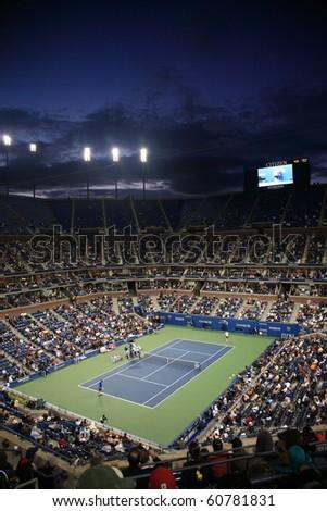 NEW YORK - SEPTEMBER 9: A crowded Arthur Ashe Stadium for a night U.S. Open tennis match on September 9, 2010 in New York. In this quarterfinal match, Mikhail Youzhny defeats Stanislas Wawrinka. - stock photo