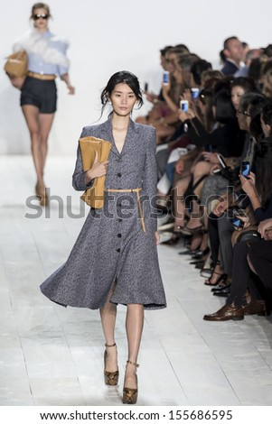 NEW YORK - SEPTEMBER 11: A model is walking the runway at Michael Kors Collection for Spring Summer 2014 fashion show during Mercedes-Benz Fashion Week on SEPTEMBER 11, 2013 in New York