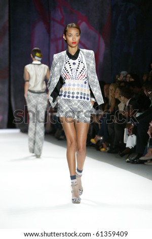 NEW YORK - SEPTEMBER 11: A model is walking the runway at the Cynthia Rowley collection presentation for Spring/Summer 2011 during Mercedes-Benz Fashion Week on September 11, 2010 in New York - stock photo