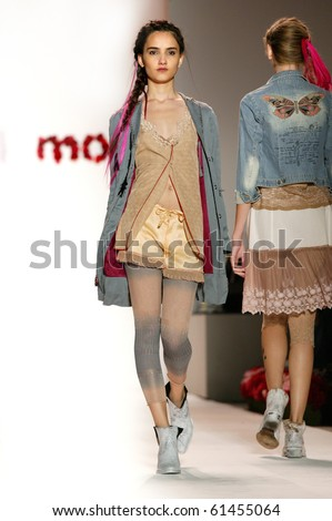 NEW YORK - SEPTEMBER 15: A model is walking the runway at the Odd Molly  collection presentation for Spring/Summer 2011 during Mercedes-Benz Fashion Week on September 15, 2010 in New York - stock photo