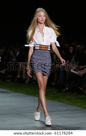 NEW YORK - SEPTEMBER 12: A model is walking the runway at Tommy Hilfiger anniversary collection presentation for Spring/Summer 2011 during Mercedes-Benz Fashion Week on September 12, 2010 in New York
