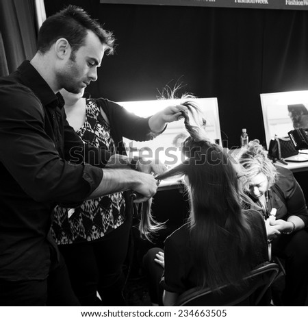 NEW YORK - SEPTEMBER 08, 2014: A model prepares backstage at the Dennis Basso Spring 2015 fashion show during Mercedes-Benz Fashion Week at The Theatre at Lincoln Center