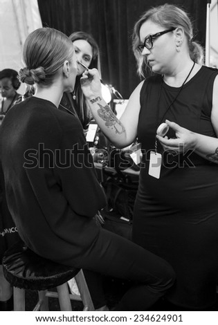 NEW YORK - SEPTEMBER 04, 2014: A model prepares backstage at the Tadashi Shoji Spring 2015 fashion show during Mercedes-Benz Fashion Week at The Salon at Lincoln Center