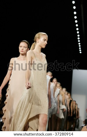 NEW YORK - SEPTEMBER 15: A model walks the runway at the Dennis Basso Collection for Spring/Summer 2010 during Mercedes-Benz Fashion Week on September 15 2009 in New York