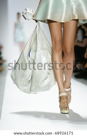 NEW YORK - SEPTEMBER 14: A model walks the runway at the Dennis Basso Collection presentation for Spring/Summer 2011 during Mercedes-Benz Fashion Week on September 14, 2010 in New York. - stock photo