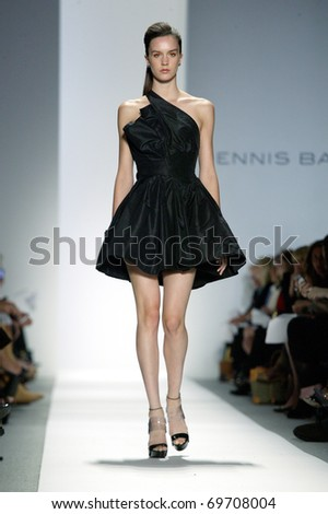 NEW YORK - SEPTEMBER 14: A model walks the runway at the Dennis Basso Collection presentation for Spring/Summer 2011 during Mercedes-Benz Fashion Week on September 14, 2010 in New York.