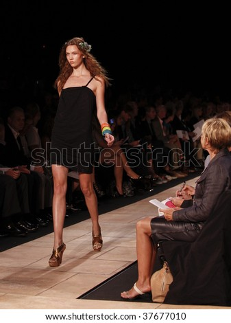 NEW YORK - SEPTEMBER 13: A model walks the runway at the Diane Von Furstenberg Collection for Spring/Summer 2010 during Mercedes-Benz Fashion Week on September 13, 2009 in New York.