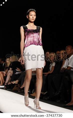 NEW YORK - SEPTEMBER 15: A model walks the runway at the Narciso Rodriguez Collection for Spring/Summer 2010 during Mercedes-Benz Fashion Week on September 15, 2009 in New York.