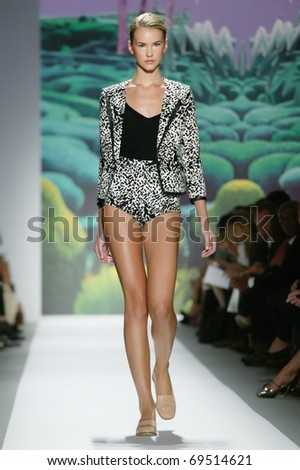 NEW YORK - SEPTEMBER 14: A model walks the runway at the TIBI  Collection presentation for Spring/Summer 2011 during Mercedes-Benz Fashion Week on September 14, 2010 in New York. - stock photo