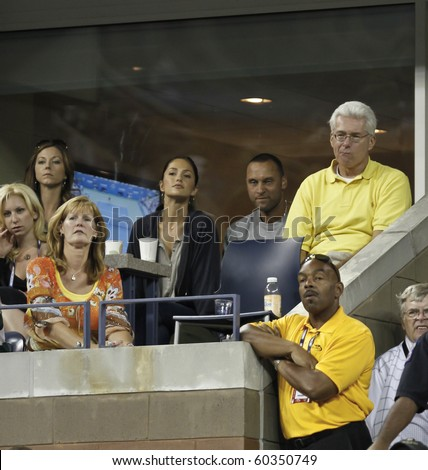 NEW YORK - SEPTEMBER 04: Actress Minka Kelly and Derek Jeter of the NY Yankees watch Novak Djokovic of Serbia plays against James Blake of USA during third round match US Open on Sep 4, 2010 New York - stock photo
