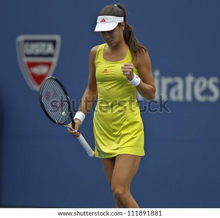 NEW YORK - SEPTEMBER 3: Ana Ivanovic of Serbia reacts during 4th round match against Tsvetana Pironkova of Bulgaria at US Open tennis tournament on September 3, 2012 in Flashing Meadows New York - stock photo