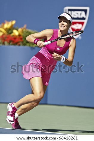 NEW YORK - SEPTEMBER 05: Ana Ivanovic of Serbia returns the ball during match against Kim Clijsters of Belgium at US Open Tennis Championship on September 05, 2010 in New York, City. - stock photo