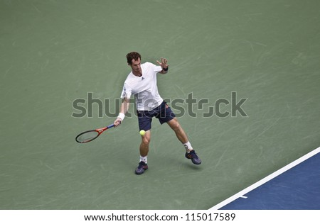 NEW YORK - SEPTEMBER 08: Andy Murray of United Kingdom returns the ball during semifinal against Tomas Berdych of Czech Republic at US Open tennis tournament on September 08, 2012 in New York City