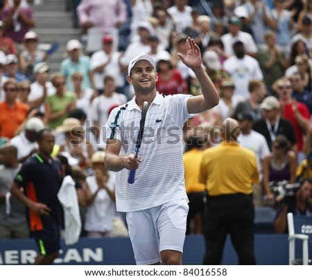 NEW YORK - SEPTEMBER 04: Andy Roddick of USA celebrates winning 3rd round match against Julien Benneteau of France at USTA Billie Jean King National Tennis Center on September 03, 2011 in NYC