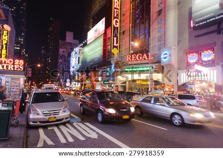 NEW YORK - SEPTEMBER 25, 2011: area around Times Square at night. Times Square is a major commercial intersection and a neighborhood in Midtown Manhattan, New York City - stock photo