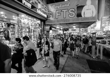 NEW YORK - SEPTEMBER 25, 2011: area near Times Square at night. Times Square is a major commercial intersection and a neighborhood in Midtown Manhattan, New York City - stock photo