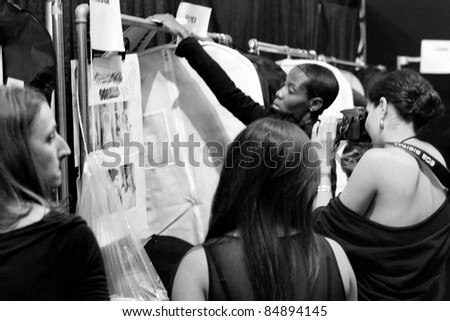 NEW YORK - SEPTEMBER 13: Backstage at the Vera Wang S/S 2012 runway collection presentation during Mercedes-Benz Fashion Week on September 13, 2011 in New York. - stock photo