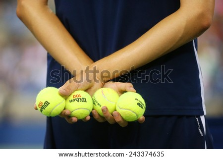 NEW YORK - SEPTEMBER 4, 2104: Ball boy holding tennis balls at the Billie Jean King National Tennis Center during US Open 2014 - stock photo