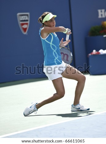 NEW YORK - SEPTEMBER 04: Beatrice Capra of USA returns a ball during match against Maria Sharapova of Russia at US Open Tennis Championship on September 04, 2010 in New York, City.